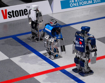 Take your mark: Robots wait for the start in a demonstration race during a news conference Wednesday in Osaka to announce the world's first full android marathon, which kicks off next Thursday. | AP PHOTO