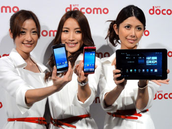 Looking smart: Models show off NTT DoCoMo Inc.'s new smart phones and tablet device during a media preview Thursday in Tokyo. | KAZUAKI NAGATA PHOTO