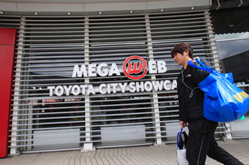 Aftershock: A man walks by the entrance of a Toyota Motor Corp. showroom in Tokyo on Wednesday. The showroom is closed until Sunday due to the Tohoku disaster. | AP