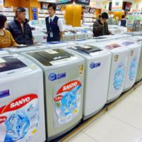 Going extinct: A row of Sanyo Electric Co. washing machines is displayed at an appliance store in Hanoi in March. | KYODO PHOTO