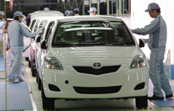 In better times: Workers give Yaris compact sedans their final check before export to North America on a new assembly line at Central Motor Co., a Toyota Motor Co. unit in Ohira, Miyagi Prefecture, on Feb. 16. | AP