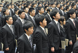 Slow start: New employees of Tohoku Electric Power Co. attend the welcoming ceremony at the firm's headquarters in Sendai on Tuesday, more than a month later than scheduled due to the March 11 quake.   KYODO