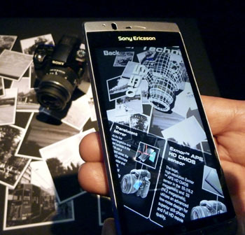 Another dimension: Sony Corp. demonstrates its new 'augmented reality' technology, which shows additional information on images captured through a camera on devices such as a smartphone, in Tokyo on Thursday.   KYODO PHOTO