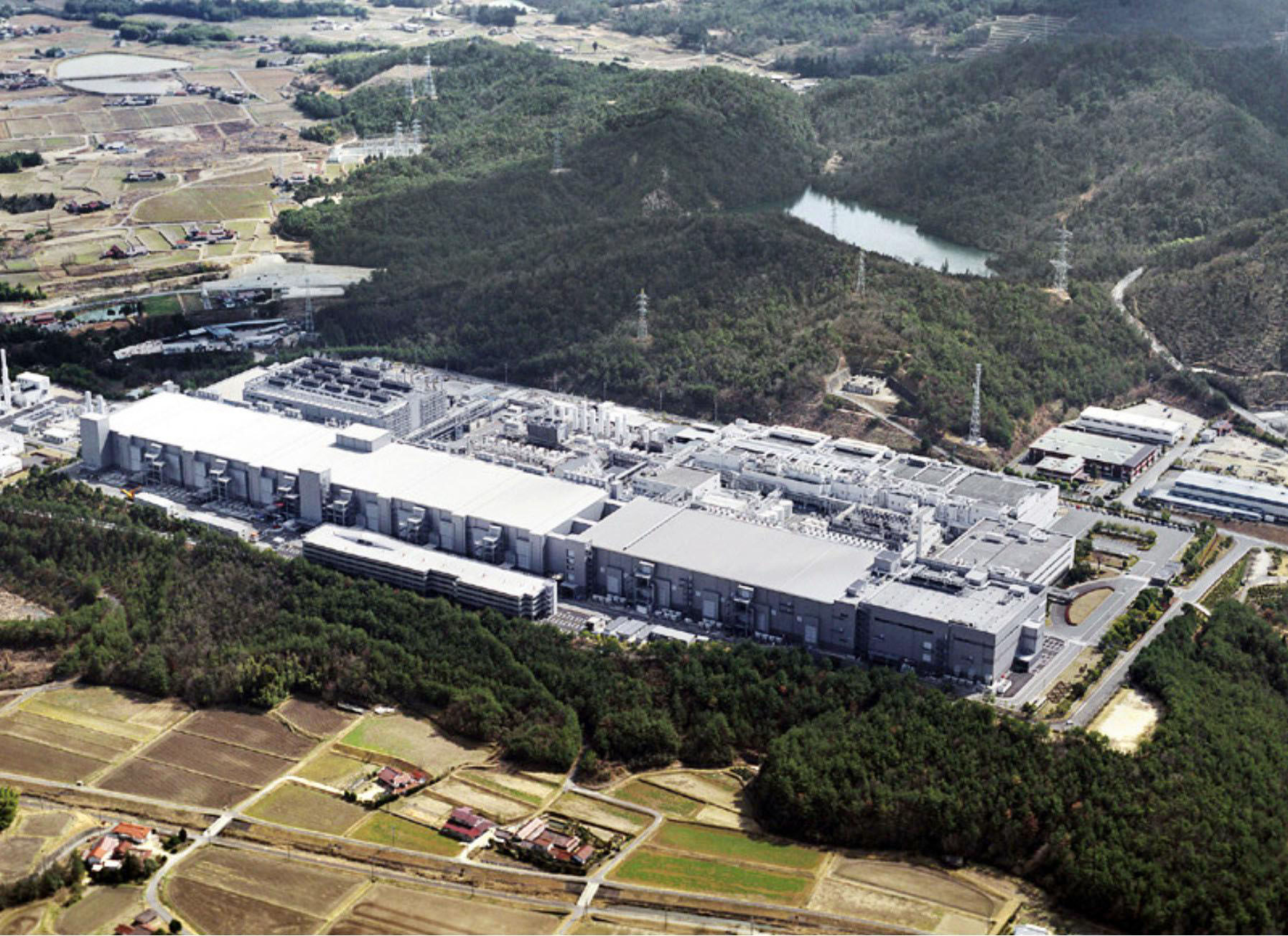 Chips down: Elpida Memory Inc.'s DRAM factory in Higashihiroshima, Hiroshima Prefecture, is seen in this undated aerial photo. | KYODO