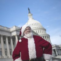 Vested interests: A man dressed as Santa listens to a speech about the 'fiscal cliff' in Washington on Dec. 12.   AFP-JIJI