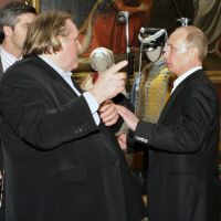 New best friends: Then Russian Prime Minister  Vladimir Putin (right) and French actor Gerard Depardieu talk during a visit to a museum in St. Petersburg in December 2010. | AP