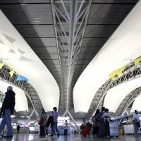 Please proceed to the gate: Passengers walk through the departure lobby in Kansai International Airport in Osaka Prefecture in 2011. | BLOOMBERG