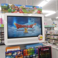 Be prepared: A trailer for the upcoming 'Dragon Quest X'game gives customers at an Osaka toy store a hint of what to expect. | BRIAN ASHCRAFT