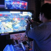 Blown away: 'Gunslinger Stratos,' a new shooting game by Square Enix, aims straight for the heart of Japanese gamers. | BRIAN ASHCRAFT