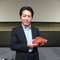 Organ donor: At an academic conference in Tokyo last month, Dr. Maki Sugimoto displayed a model of a human liver made partly on a 3-D printer.
