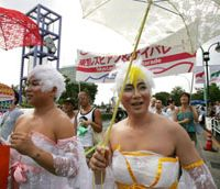 Gaiety: Men in drag take part in the Tokyo Gay and Lesbian Parade, which was revived after a 2 1/2-year hiatus, in Tokyo in August 2005. | AP PHOTO
