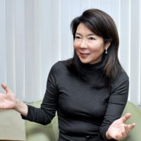 Boardroom pioneer: Kumi Sato, president and CEO of Cosmo Public Relations Corp., is interviewed at her office in Minato Ward, Tokyo, on Dec. 9. | YOSHIAKI MIURA PHOTO