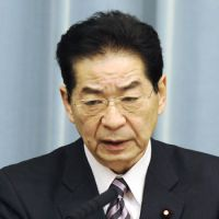Under fire: Chief Cabinet Secretary Yoshito Sengoku points during a news conference Thursday at the prime minister's office. | KYODO PHOTO
