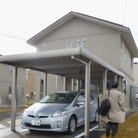 Energy test: This 'smart house' unveiled in November in the village of Rokkasho, Aomori Prefecture, has a computer system that automatically controls electricity consumption. The plug-in hybrid vehicle parked in front of the house is also part of the renewable energy experiment. | KYODO PHOTO
