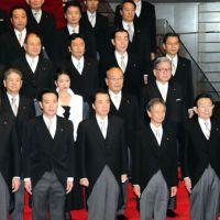Sworn-in: Prime Minister Naoto Kan (center front) and his new Cabinet pose Friday after their appointment earlier in the day at the prime minister's office. | SATOKO KAWASAKI PHOTO