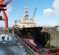 Season over: A ship belonging to Kanai Gyogyo, one of four fishery firms ordered to halt operations relating to Alaska pollack, sits tied to a pier Tuesday in Kushiro, Hokkaido. | KYODO PHOTO