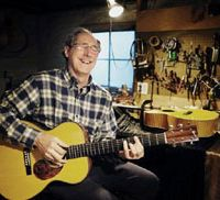 Firstborn: John Greven plays the first guitar he built for himself at his home in Portland, Ore., in November. | KYODO PHOTO