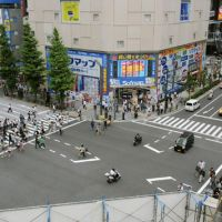 Sense of normalcy: People cross an intersection in Tokyo's Akihabara district in July. The area's pedestrian-only zone will be reinstated Sunday for the first time since a man in a truck went on a murderous rampage in June 2008. | KYODO PHOTO