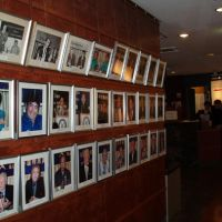 Keynote speakers: Pictures of various guests who have appeared at press conferences held at the Foreign Correspondents' Club of Japan in the past are displayed on a wall in the club in central Tokyo. | SATOKO KAWASAKI PHOTOS
