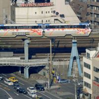 Suspended animation: A Tokyo Monorail Line train sits on an overpass Friday after being stranded by a fire at a power substation near Tennozu Isle Station. | KYODO PHOTO