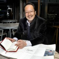 Minimalist: Harry Cheng, founder and president of La Ditta Limited, shows off a copy of 'Been There Done That,' a travel diary he produced, at the International House of Japan in Tokyo's Roppongi district on Jan. 27.   YOSHIAKI MIURA PHOTO