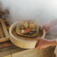 Steamy cuisine: A vegetable and fish dish is prepared using a special steamer that lowers the temperature of steam from a hot spring in Beppu, Oita Prefecture. | KYODO PHOTO