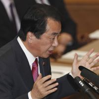 Head-to-head: Prime Minister Naoto Kan answers questions from Sadakazu Tanigaki, leader of the Liberal Democratic Party, during a one-on-one debate in the Upper House on Feb. 9. | AP PHOTO