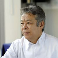 Cooking up more: Renowned chef Tateru Yoshino poses during a recent interview. | KYODO PHOTO