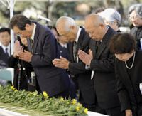 War legacy: People pray for the war dead during a memorial service Tuesday in central Tokyo for Imperial Japanese soldiers who died in the 1945 Battle of Iwojima. | KYODO PHOTO