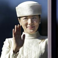 Crown Princess Masako waves from a balcony of the Imperial Palace as Emperor Akihito makes a public appearance to mark his 77th birthday on Dec. 23.