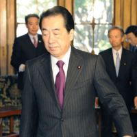 On the way out?: Prime Minister Naoto Kan exits a room at the Diet before attending a regular Cabinet meeting Tuesday. | KYODO PHOTO