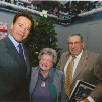 Fighting to the end: Lester Tenney, 90, a former American prisoner of war, and his wife, Betty, meet in September with then California Gov. Arnold Schwarzenegger in San Diego to solicit a call from him for Japanese firms to apologize to former POWs. | COURTESY OF LESTER TENNEY / KYODO