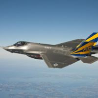 High stakes: An F-35C fighter jet prototype conducts a test flight over Chesapeake Bay. U.S. | NAVY / AP