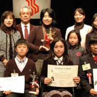 Gift of gab: Ayumi Yoshida (front row, center) holds the winner's certificate while her mother, Wakaba, holds a trophy after the All Japan Junior English Speech Contest in Tokyo in early February. | COURTESY OF HATANO ENGLISH HOUSE