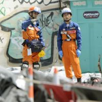 Helping hands: Members of Japan's disaster relief team in quake-hit Christchurch, New Zealand, work at the collapsed CTV building Saturday.   KYODO PHOTO