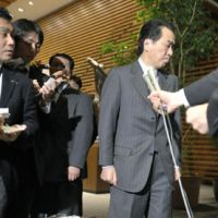 Rocked: Prime Minister Naoto Kan walks away from a press conference Sunday evening after expressing his condolences to the family of Yoshiko Hirauchi, 61, the first Japanese fatality confirmed from the recent earthquake in New Zealand. He made no remarks about the resignation of Foreign Minister Seiji Maehara.   KYODO PHOTO