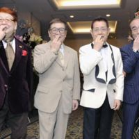Funnymen: Kato Cha (third from left), makes his signature pose along with other members of the Drifters (from left) Takagi Boo, Nakamoto Koji and Shimura Ken during an event celebrating his 50 years in the entertainment business last week in Tokyo. | KYODO PHOTO