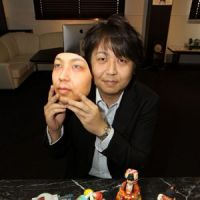 Seeing double: Masao Ito, president of One Face, holds his face mask in Kasugai, Aichi Prefecture. | CHUNICHI SHIMBUN