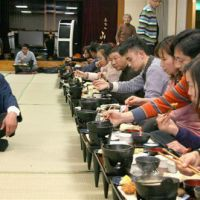 When in Rome: Chinese tourists have dinner at a Japanese inn run by a Chinese businessman (left) who goes by the Japanese name Ryunosuke Hayashi, at the Isawa hot spring resort in Yamanashi Prefecture in January.   KYODO PHOTO