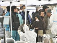 Hot or not: People are checked for radiation exposure in Koriyama, Fukushima Prefecture, on Tuesday.   KYODO PHOTO