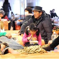Displaced: A family who evacuated from Fukushima Prefecture to escape the nuclear power plant crisis takes a rest with other evacuees at Saitama Super Arena in Saitama Prefecture on Friday.   SATOKO KAWASAKI PHOTO