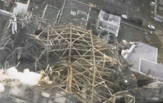 Smoke signal: An aerial shot shows white smoke spewing from the crippled No. 3 reactor at the Fukushima No. 1 nuclear power station on Wednesday. | TEPCO / KYODO