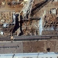 Stricken: A satellite photo taken Friday shows damage to the buildings that house reactors No. 3 (right) and No. 4 at the Fukushima No. 1 nuclear plant.   KYODO PHOTO/DIGITALGLOBE