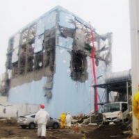 Pump it up: Water-spraying operations to cool down a spent nuclear-fuel pool at the Fukushima No. 1 power plant's No. 4 reactor continue Tuesday with trucks using a concrete squeeze pump and a 50-meter arm for pouring water from a higher point.   KYODO PHOTO