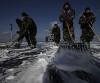 Swabbies: U.S. Navy crew members mop up the flight deck to remove radioactive contamination from the aircraft carrier USS Ronald Reagan, off Japan's northeast coast Wednesday.   AP PHOTO