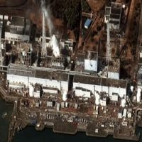 Crisis zone: Reactors No. 1 through 4 (left to right) are shown at the Fukushima No. 1 nuclear power plant in Fukushima Prefecture in this satellite photo taken March 16 by the Institute for Science and International Security, with white smoke emanating from reactor No. 3. | DIGITALGLOBE / KYODO