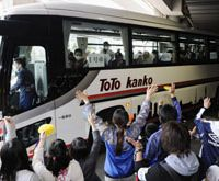 Next stop: Evacuees from Futaba, Fukushima Prefecture, are seen off by volunteers as they leave their temporary shelter at Saitama Super Arena on Wednesday.   KYODO PHOTO