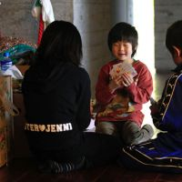 Iwate hold 'em: Young evacuees play cards at an evacuation center in Ofunato, Iwate Prefecture, on Friday. | AP PHOTO