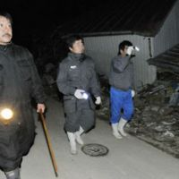 Thwarting thieves: A neighborhood watch group in disaster-torn Onagawa, Miyagi Prefecture, carries out a night patrol late last month. | KYODO PHOTO