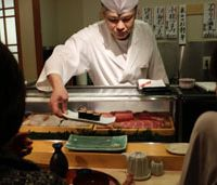 Last order?: A chef serves fatty tuna rolls at a sushi restaurant in Tokyo on Tuesday. Fishermen near the Fukushima No. 1 nuclear plant are worried that leakage of radioactive water into the ocean could cost them their livelihoods. | AP PHOTO
